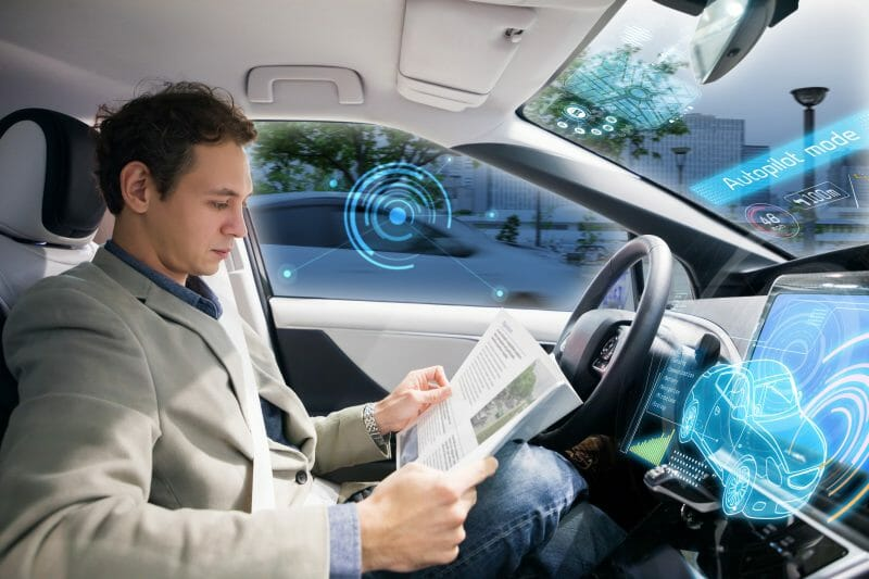 How to invest here and now in the driverless car future