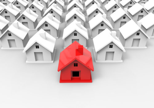 Is it better to buy an investment property or home first?